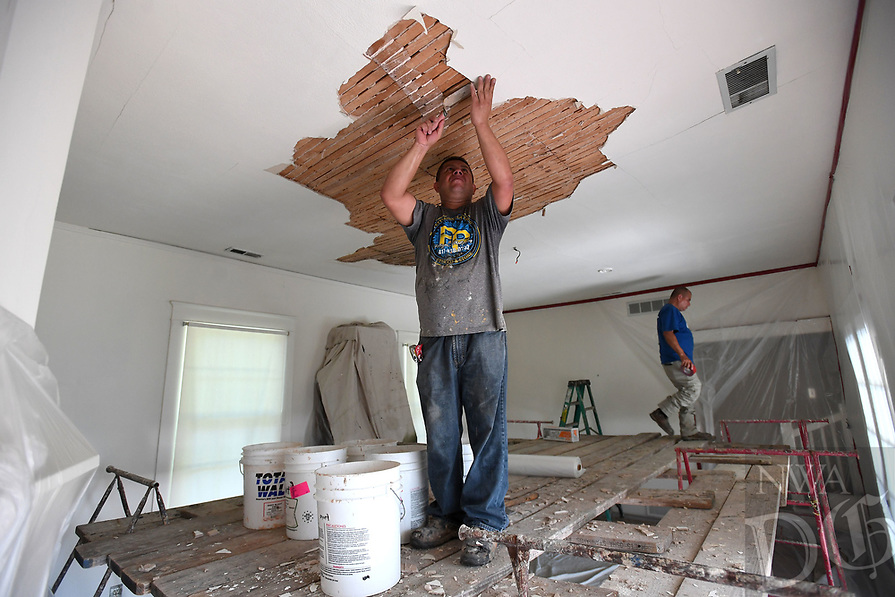 NWA Democrat-Gazette/J.T. WAMPLER Jorge Casteneda of Rogers works with a crew from Pettyjohn Plastering Monday August 12, 2019 to fix the ceiling in the Searcy House on the grounds of the Shiloh Museum of Ozark History in Springdale. The damage was caused when the ceiling sagged with age, causing the plaster to crack and fall.