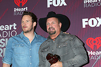LOS ANGELES - MAR 14:  Chris Pratt, Garth Brooks at the iHeart Radio Music Awards - Press Room at the Microsoft Theater on March 14, 2019 in Los Angeles, CA