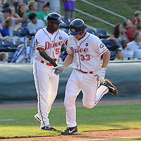 July 29, 2009: Catcher Ryan Lavarnway (33) of the Greenville Drive is congratulated by coach Billy McMillon after hitting a home run during a game at Fluor Field at the West End in Greenville, S.C. Photo by: Tom Priddy/Four Seam Images