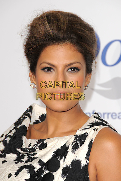 """EVA MENDES .The Picturehouse Premiere of """"The Women"""" held at The Mann Village theatre in Westwood, California, USA..September 4th, 2008.headshot portrait mendez black white pattern .CAP/DVS.©Debbie VanStory/Capital Pictures."""