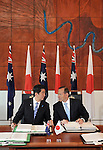 AUSTRALIA, Canberra : Japanese Prime Minister Shinzo Abe (L) and Australian Prime Minister Tony Abbott (R) prepare to sign the Japan - Australia Economic Agreement and the Agreement on the Transfer of Defence Equipment and Technology, at Parliament House in Canberra on July 8, 2014. Defence ties are set to take centre stage when Australia plays host to Japanese Prime Minister Shinzo Abe this week, as the two countries look set to strengthen their relationship through annual leaders' meetings. AFP PHOTO / Mark GRAHAM