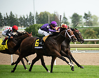 TORONTO, ONTARIO - JUNE 30. #6, Long on Value takes the Breeders Cup Challenge Grade I Highlander Stakes for Owners Madaket Stables LLC, Ten Strike Racing, and Steve Layman; Florent Geroux aboard for Trainer Brad Cox during the 159th Queen's Plate Festival at Woodbine Racetrack in Toronto, Ontario, Canada. (Photo by Carson Dennis/Eclipse Sportswire/Getty Images)