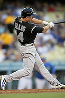 Colorado Rockies second baseman Mark Ellis #14 bats against the Los Angeles Dodgers at Dodger Stadium on July 26, 2011 in Los Angeles,California. Los Angeles defeated Colorado 3-2.(Larry Goren/Four Seam Images)