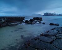 The old stone breakwater at Myrland, Flakstadøy, Lofoten Islands, Norway