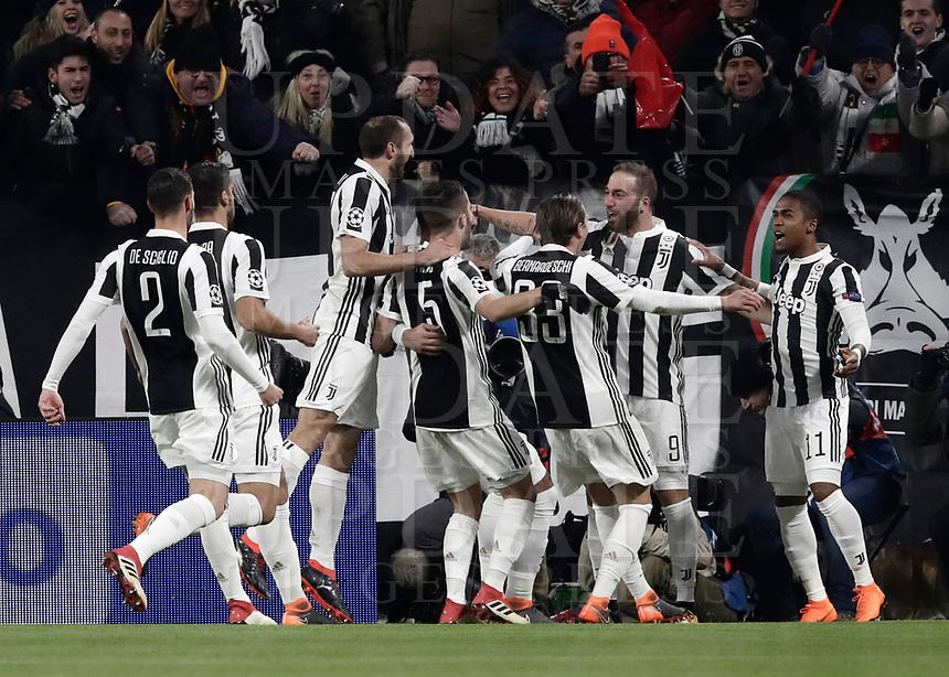 Football Soccer: UEFA Champions League Juventus vs Tottenahm Hotspurs FC, Allianz Stadium. Turin, Italy, February 13, 2018. <br /> Juventus' Gonzalo Higuain celebrates with his teammates after scoring during the Uefa Champions League football soccer match between Juventus and Tottenahm Hotspurs FC  at Allianz Stadium in Turin, February 13, 2018.<br /> UPDATE IMAGES PRESS/Isabella Bonotto
