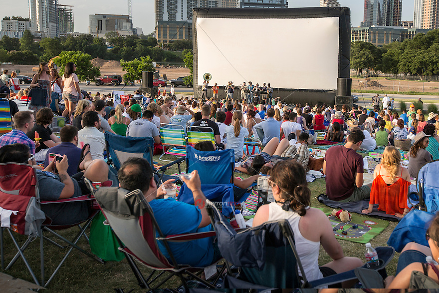 It's a hot summer's day in Austin, Texas as the band takes the stage at the Austin Sound & Cinema. Blankets and chairs overtake the lawn at this popular weekly summertime event providing live music and popular movies on the lawn of the Long Center.