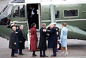 First Lady Melania Trump and former First Lady Michelle Obama watch Former President of the United States Barack Obama shakes hands with newly elected United States President Donald Trump as they walk to Marine One at the Capitol Building after Trump is sworn in at the 58th Presidential Inauguration on Capitol Hill in Washington, D.C. on January 20, 2017.  <br /> Credit: John Angelillo / Pool via CNP