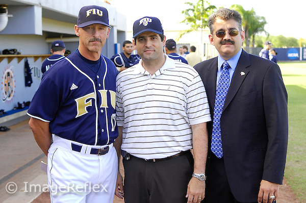 "2 April 2008: Hialeah Gardens Mayor Yioset De La Cruz (middle), Florida International Baseball Head Coach Henry ""Turtle"" Thomas (left) and FIU's Director of Intercollegiate Athletics Pete Garcia (right) pose after Mayor De La Cruz threw out the first pitch prior to the start of FIU's game against the University of Miami at University Park Stadium in Miami, Florida."
