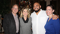 NWA Democrat-Gazette/CARIN SCHOPPMEYER Rick and Julie Roblee  (from left) and Boo Buchanan and Sara Fennel Buchanan welcome Restore Humanity supporters to a reception at the Roblee home Nov. 30.