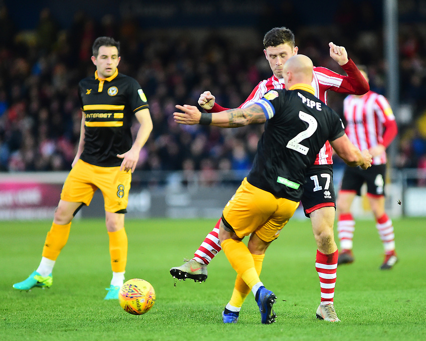 Lincoln City's Shay McCartan vies for possession with  Newport County's David Pipe<br /> <br /> Photographer Andrew Vaughan/CameraSport<br /> <br /> The EFL Sky Bet League Two - Lincoln City v Newport County - Saturday 22nd December 201 - Sincil Bank - Lincoln<br /> <br /> World Copyright © 2018 CameraSport. All rights reserved. 43 Linden Ave. Countesthorpe. Leicester. England. LE8 5PG - Tel: +44 (0) 116 277 4147 - admin@camerasport.com - www.camerasport.com