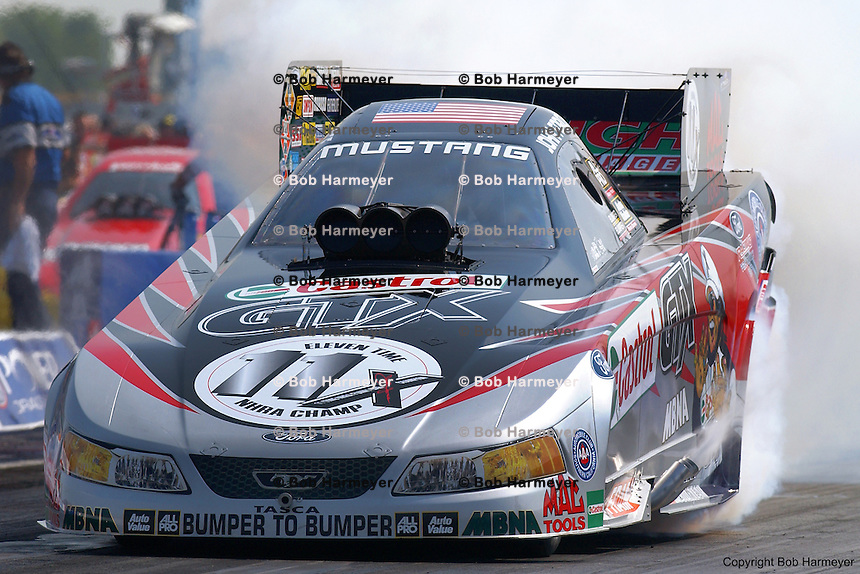 CLERMONT, IN - SEPTEMBER 2: John Force performs a burnout in his Funny Car during the Mac Tools US Nationals on September 2, 2002, at Indianapolis Raceway Park near Clermont, Indiana.