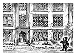 (A policeman looking at the windows of a flat whose windows are taped over in a swastika pattern)