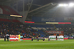 The two teams take part in a minutes remembrance for the victims of the Brussels terror attacks during the international friendly match at the Cardiff City Stadium. Photo credit should read: Philip Oldham/Sportimage