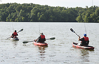 NWA Democrat-Gazette/FLIP PUTTHOFF<br />Paddlers head out on Lake Fayetteville for a morning of fishing on July 8 2017. Heroes on the Water offers kayak fishing trips to veterans, firefighters and law enforcement at no charge.
