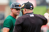 Augusta GreenJackets manager Mike Goff (9) argues a call with home plate umpire Kevin Morgan during the South Atlantic League game against the Greensboro Grasshoppers at NewBridge Bank Park on August 11, 2013 in Greensboro, North Carolina.  The GreenJackets defeated the Grasshoppers 6-5 in game one of a double-header.  (Brian Westerholt/Four Seam Images)
