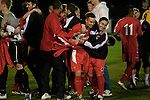 Walsall Wood FC 1 Atherstone Town 0, 02/05/2013. Oak Park, Midland Football Combination Premier Division. Walsall Wood players celebrating at the final whistle against Atherstone Town at Oak Park. The club were crowned champions of the Midland Football Combination premier division the previous night due to results elsewhere, their first league win in 61 years. Walsall Wood, who were formed in 1915, won the match 1-0 watched by 69 spectators. The club's main stand is unique to English football and only one of two in the UK, the other being at Arbroath FC in Scotland. Photo by Colin McPherson.