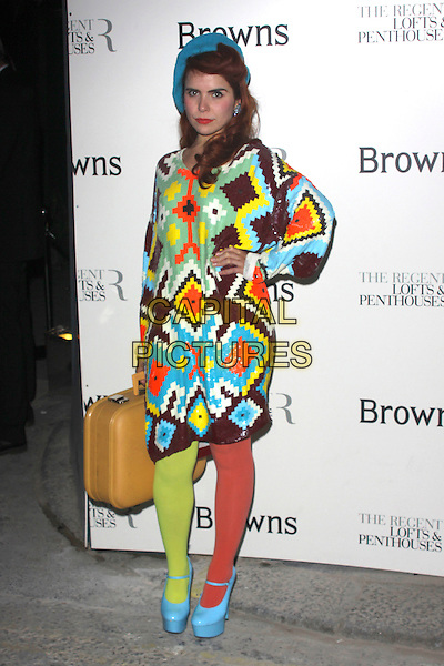 PALOMA FAITH .Attends the 40th anniversary celebrations of Browns fashion boutique, Marshall Street, London, England, UK, May 12th, 2010..arrivals full length dress hand on hip two tone tights platform patent shoes mary janes blue turquoise hat beret green yellow orange shiny patterned pattern sequined sequin brown v-neck oversized suitcase .CAP/AH.©Adam Houghton/Capital Pictures.