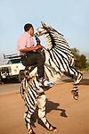 Man rides painted donkey