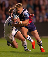 Bristol Bears' Ian Madigan evades the tackle of Bath Rugby's Chris Cook<br /> <br /> Photographer Bob Bradford/CameraSport<br /> <br /> Gallagher Premiership - Bristol Bears v Bath Rugby - Friday August 31st 2018 - Ashton Gate - Bristol<br /> <br /> World Copyright © 2018 CameraSport. All rights reserved. 43 Linden Ave. Countesthorpe. Leicester. England. LE8 5PG - Tel: +44 (0) 116 277 4147 - admin@camerasport.com - www.camerasport.com