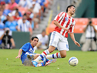 Guatemala defender Jonathan Lopez (23) fouled Paraguay forward Marcelo Estagarribia (10) Guatemala tied Paraguay 3-3 in a international friendly match at RFK Stadium, Wednesday August 15, 2012.