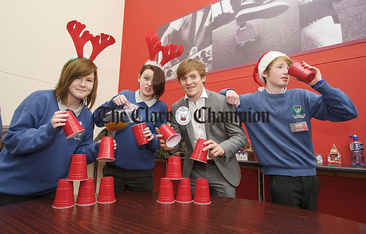 Clare GAA player Podge Collins of AIB with transition year members of the St Flannan's Build A Bank committee Patricia Bartnik, Leah Daniels and Jason Herbert during their Bush Tucker trials as part of their promotion for the bank. Photograph by John Kelly.