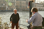 Woody Allen being photographed by the foreign press duing a stay at the Gritti Hotel in Venice, Italy..December 15, 2004.(Publicist Lucy Darwin in the foreground).© Walter McBride /