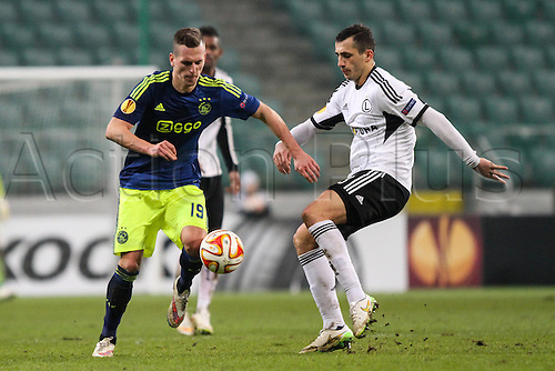 26.02.2015. Warsaw, Poland. Europa League football. Legia Warsaw versus Ajax.  Arkadiusz Milik (Ajax) gets past Tomasz Jodlowiec (Legia)