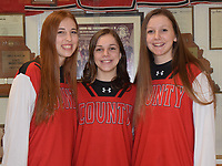 RICK PECK/SPECIAL TO MCDONALD COUNTY PRESS<br /> McDonald County honored senior members of the Lady Mustang basketball team prior to their game against Carl Junction on Feb. 21 at MCHS. From left to right: Alexia Kitlen, Samantha Frazier and Mattie Leach.