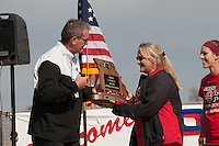 Jackson Coach Andrea Talley accepts the Class 4 Girls State Cross Country Trophy from a MSHSAA official Saturday, November 5, 2016.