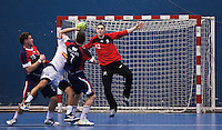 02 NOV 2011 - LONDON, GBR - Britain's Bobby White (right) leaps to try and block a shot during the Men's 2013 World Handball Championship qualification match against Israel at the National Sports Centre at Crystal Palace (PHOTO (C) NIGEL FARROW)