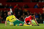 Anthony Martial of Manchester United brought down by Grant Hanley of Norwich City during the Premier League match at Old Trafford, Manchester. Picture date: 11th January 2020. Picture credit should read: James Wilson/Sportimage