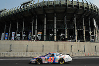 04/19/08 Mexico City .Kelly Bires races his Ford Fusion through turn 8 past the stadium.