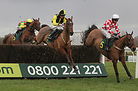 Camden ridden by Leighton Aspell (R) in jumping action ahead of Frontier Spirit ridden by Sam Twiston-Davies and Cross Of Honour ridden by Richard Johnson during the Betfair Commits £40m to British Racing Handicap Chase - Horse Racing at Fakenham Racecourse, Norfolk