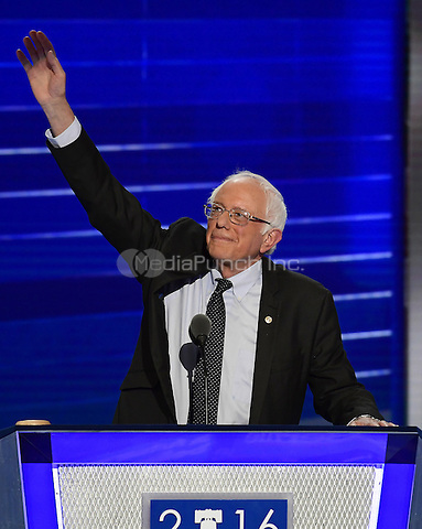 United States Senator Bernie Sanders (Independent of Vermont) acknowledges the cheers as he prepares to make remarks at the 2016 Democratic National Convention at the Wells Fargo Center in Philadelphia, Pennsylvania on Monday, July 25, 2016.<br /> Credit: Ron Sachs / CNP/MediaPunch<br /> (RESTRICTION: NO New York or New Jersey Newspapers or newspapers within a 75 mile radius of New York City)