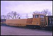3/4 right-front view of Herzog ballast spreader MPM111 (MPM=Multi-Purpose Machine).  &quot;Series - Held End of Track (EPA Stuff) Clean-up Train&quot;.<br /> Herzog  Monte Vista, CO  Taken by Berkstresser, George - 3/2003