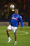 40-year-old former Jamaican international Ian Goodison taking part in the home team's pre-match warm-up at Prenton Park before Tranmere Rovers host Stoke City in a Capital One Cup third round match. The Capital One cup was formerly known as the League Cup and was competed for by all 92 English Premier League and Football League clubs. Visitors Stoke City won the match 2-0, watched by a crowd of 5,559 spectators.