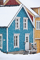 Traditional architecture wooden buildings along Storgata in the quaint area of the city of Tromso, in the Arctic Circle in Northern Norway