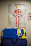A towel with a club crest in the physio's room at Mansfield Town's Field Mill stadium during an open day held for the club's supporters. Mansfield Town achieved promotion back to England's Football League by winning the Conference National in season 2012-13. Field Mill was the oldest ground in the Football League, hosting football since 1861 although some reports date it back as far as 1850, with Mansfield Town having played there since 1919.