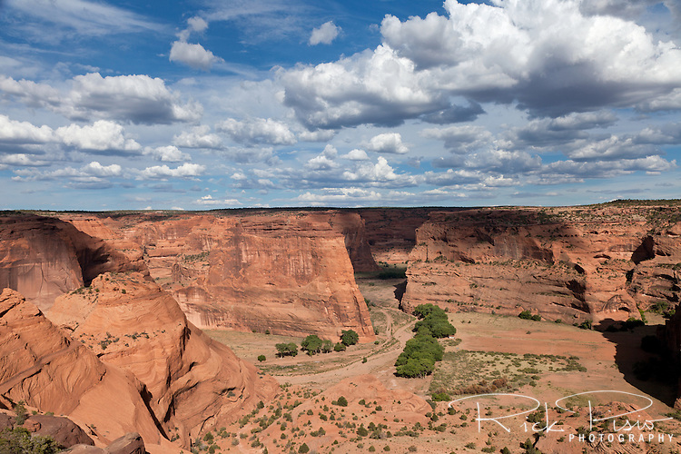 Clouds drift over a maze of red sandstone cliffs at Canyon de Chelly National Monument on the Navajo Reservation in Arizona.