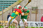 Kerry's hero Mikey Boyle drives past Paul Doyle on his way to score Kerry's third goal to clinch victory against Carlow during their NHL game in Tralee on Sunday