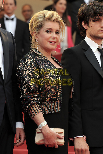 CATHERINE DENEUVE.The closing ceremony of the 64th Cannes Film Festival, Cannes..May 22nd, 2011.half length black beige lace jacket side clutch bag dress.CAP/JG.©Jacques Garrel/Capital Pictures
