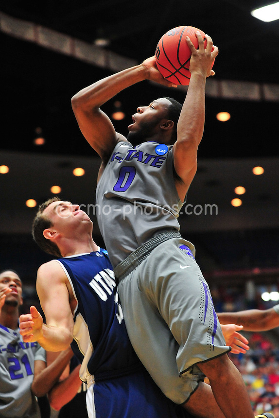 Mar 17, 2011; Tucson, AZ, USA; Kansas State Wildcats guard Jacob Pullen (0) shoots the ball in the second half of a game against the Utah State Aggies in the second round of the 2011 NCAA men's basketball tournament at the McKale Center.  The Wildcats won 73-68.