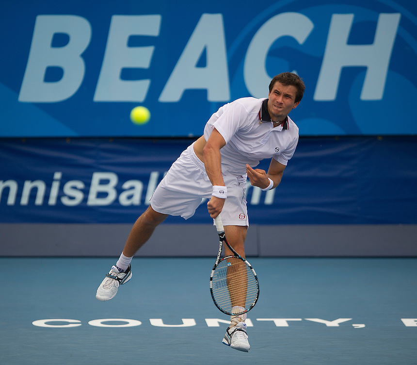 Evgeny Donskoy (RUS) in action during his victory over Steve Darcis (BEL) in their First Round match today - E Donskoy (RUS) d S Darcis (BEL) 7-6(5) 6-3..ATP 250 Tennis - 2012 Delray Beach International Tennis Championships - Day 1 -  Monday 25th February 2013 - Delray Beach Stadium & Tennis Center - Delray Beach - Florida - USA..© CameraSport - 43 Linden Ave. Countesthorpe. Leicester. England. LE8 5PG - Tel: +44 (0) 116 277 4147 - admin@camerasport.com - www.camerasport.com