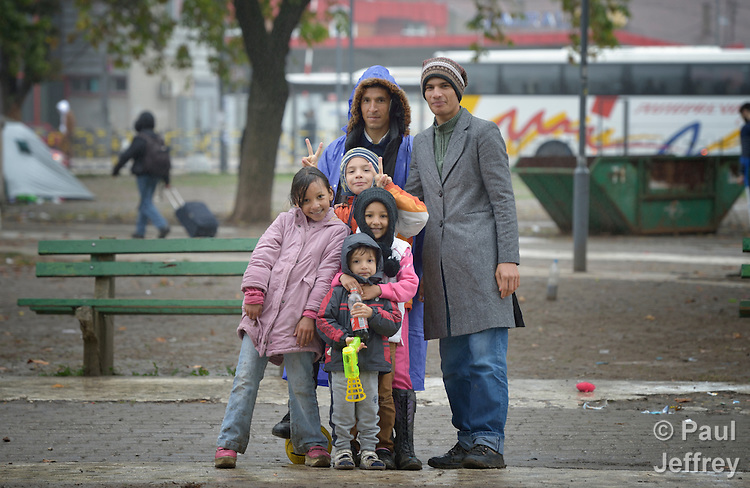 Afghan refugees pose in a city park in Belgrade, Serbia. The park has filled with refugees from several countries stopping over on their way to Germany, Sweden, Holland, and elsewhere.
