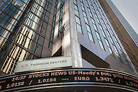 Stock tickers is seen on Thomson Reuters offices in Toronto April 19, 2010.