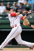 Catcher Carlos Coste (7) of the Greenville Drive bats in a game against the Asheville Tourists on Sunday, July 20, 2014, at Fluor Field at the West End in Greenville, South Carolina. Asheville won game two of a doubleheader, 3-2. (Tom Priddy/Four Seam Images)