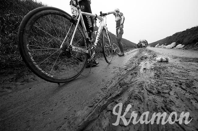 Dwars Door Vlaanderen 2013.various riders crashed (hard) because of thick mud on the fast Ladeuze descent
