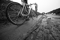 Dwars Door Vlaanderen 2013.various riders crashed (hard) because of thick mud on the fast Ladeuze descent