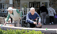 SOUTHAMPTON, PA - APRIL 17:  Helen Relick (L) and Jack Schaffer (R) find pick up eggs during an Easter Egg hunt for residents at Southampton Estates April 17, 2014 in Southampton, Pennsylvania. (Photo by William Thomas Cain/Cain Images)