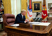 United States President Donald J. Trump accompanied by US Attorney General William P. Barr, makes remarks before signing an executive order in the Oval Office of the White House in Washington, DC that will punish Facebook, Google and Twitter for the way they police content online, Thursday, May 28, 2020. <br /> Credit: Doug Mills / Pool via CNP/AdMedia